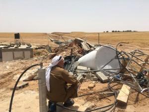 Al Mirkez man with rubble COMET